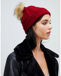 33d17233ed3 Missguided Contrast Faux Fur Pom Pom Beanie in Green - Lyst