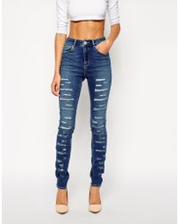 Asos Ridley High Waist Ultra Skinny Jeans in Busted Blue with Extreme Rips - Lyst