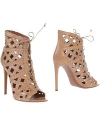 Alaïa Beige Ankle Boots - Lyst