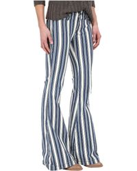 Free People | Jolene Stripe Flare Jeans | Lyst