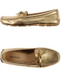 Prada Gold Moccasins - Lyst