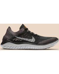 e5e3968974a6 Lyst - Nike Free Rn Flyknit - Women s Nike Free Rn Flyknit Sneakers