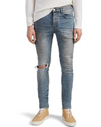 Purple - Distressed Skinny Jeans - Lyst