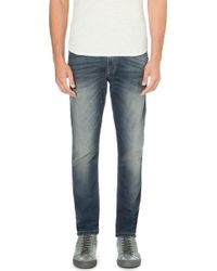 Diesel Krooley Tapered Low-rise Stretch-denim Jeans Blue - Lyst