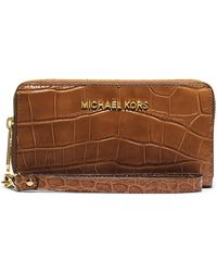 MICHAEL Michael Kors Leather Large Multi-Function Phone Case brown - Lyst