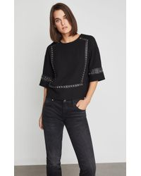 BCBGMAXAZRIA - Bcbg Faux Leather-trimmed Studded Blouse - Lyst