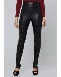 Bebe - Laced Faux Leather Leggings - Lyst