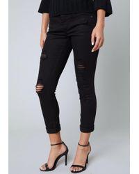 Bebe - Ripped Heartbreaker Jeans - Lyst