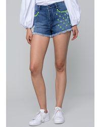 Bebe - Pyramid Stud Cutoff Shorts - Lyst