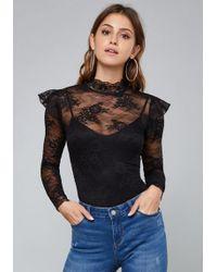 Bebe - Ruffled Lace Bodysuit - Lyst