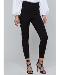 Bebe - Laced Chain Leggings - Lyst