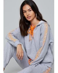 Bebe - Logo Studded Lace Up Hoodie - Lyst