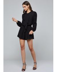 f8ad77dbc804 Lyst - Bebe Amalia Off Shoulder Romper in Black