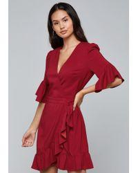 Bebe - Ruffled Wrap Dress - Lyst