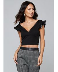 2a0cfe71bf5050 Lyst - Bebe Dotted Off Shoulder Top in Black