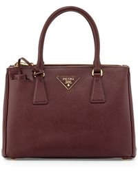 43d8823408a Prada Saffiano Extra-mini Executive Leather Bag in Red - Lyst