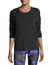 Onzie - Braided-back Long-sleeve Crewneck Performance Top - Lyst