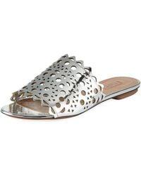 3ee7b8e524c9c Balenciaga. Giant Studded Leather Sandal.  795. Neiman Marcus · Alaïa -  Laser-cut Flat Slide Sandals - Lyst