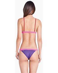 db1ffa26636cb Triya - Mira Color Block Cheeky Bikini Bottom - Royal Purple/hot Pink - Lyst