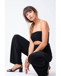 Norma Kamali - Strapless Cut Out Jumpsuit - Black - Lyst