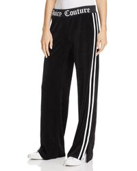 Juicy Couture - Logo Flare Velour Pants - Lyst