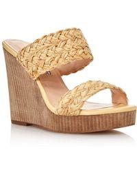 22539f8cf73b Stuart Weitzman Flatty Raffia Wedge Sandals in Metallic - Lyst