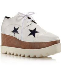 b156d571db08 Stella McCartney - Women s Elyse Transparent Stars Lace-up Platform Sneakers  - Lyst