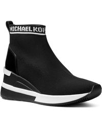 2b1b66a5c4f3e MICHAEL Michael Kors - Women s Skyler Knit Slip-on Trainer Boots - Lyst