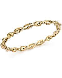 Bloomingdale's - Twist Slip-on Bangle Bracelet In 14k Yellow Gold - Lyst