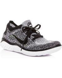 c9796100d4ba Lyst - Nike Women s Free Rn Flyknit 2018 Lace Up Sneakers in Black