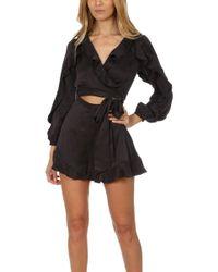 18bd82b2d2 Lyst - Zimmermann Silk Plunge Playsuit in Black