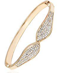 Peermont - Gold And White Swarovski Elements Bow Bangle - Lyst
