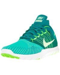 72086767e999 Lyst - Nike Women s Flex Adapt Tr Running Sneakers From Finish Line ...