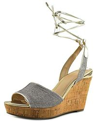 Guess - Women's Edinna Wedge Sandal, Gold/old Gold/glamour, Size 7.0 - Lyst