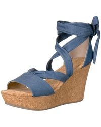 50da3a364db Michael Michael Kors Warren Platform Wedge Sandal in Metallic - Lyst