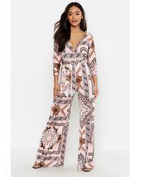 aa82acd4403 Boohoo - Plus Slinky Chain Print Wide Leg Plunge Jumpsuit - Lyst