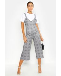 Boohoo - Dogtooth Buckle Detail Pinafore Jumpsuit - Lyst