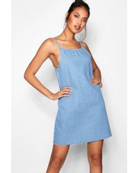 Boohoo - Loose Low Back Strappy Denim Dress - Lyst