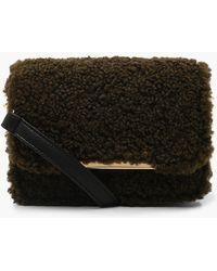 ff3a168d03ad Lyst - TOPSHOP Teddy Faux Fur Cow Shoulder Bag in Black