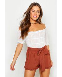 Boohoo - Petite Frill Hem Tie Waist Shorts - Lyst