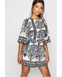 8a729286a5 Boohoo - Embroidered Boutique Detail Playsuit - Lyst
