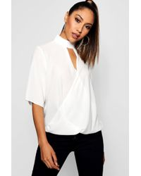97afccb32b7a Boohoo - High Neck Cut Out Choker Wrap Front Blouse - Lyst