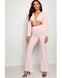 Boohoo - Bell Sleeve Tie Front Flare Trouser Co-ord Set - Lyst