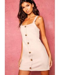 a3f0e14214 Boohoo - Horn Button Cross Back Bonded Suede Pinafore Dress - Lyst