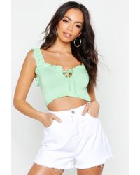 82a32ecf8a22 Boohoo One Shoulder Buckle Detail Crop Top in White - Lyst
