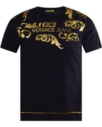 9f1acf81 Versace Jeans - Black T-shirt With Gold Foil Baroque Print - Lyst