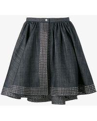 Alaïa - Flared Denim Wrap Skirt - Lyst