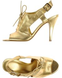 Nine West Sandals gold - Lyst