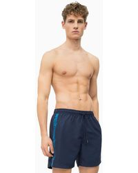 49c04ab08746d Calvin Klein Men s Ck One Logo Tape Swim Shorts in Blue for Men - Lyst