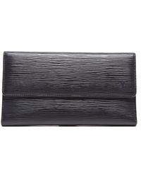Louis Vuitton Pre-owned Porte Tresor International Wallet - Lyst